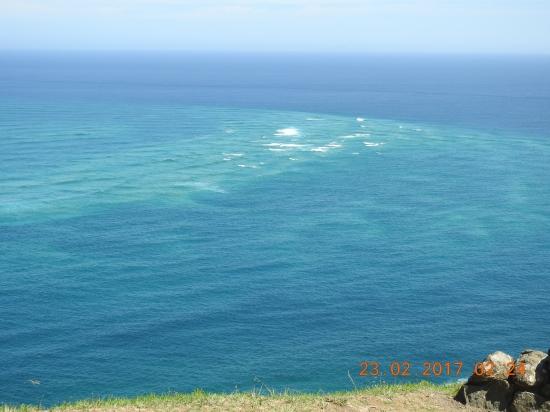 Whirlpools mark where dark blue of Pacific meets light green of Tasman Sea Cape Reinga NZ